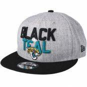 Keps Jacksonville Jaguars 2018 NFL Draft On-Stage Grey/Black Snapback - New Era - Grå Snapback